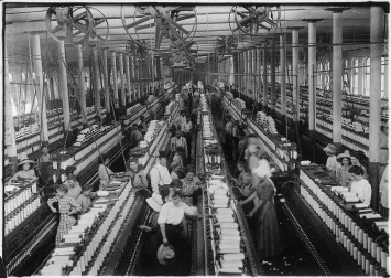 Interior_of_Magnolia_Cotton_Mills_spinning_room._See_the_little_ones_scattered_through_the_mill._All_work._Magnolia..._-_NARA_-_523307
