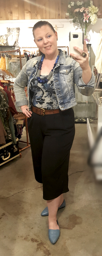 Jean jacket and black capri trousers for a business casual look.