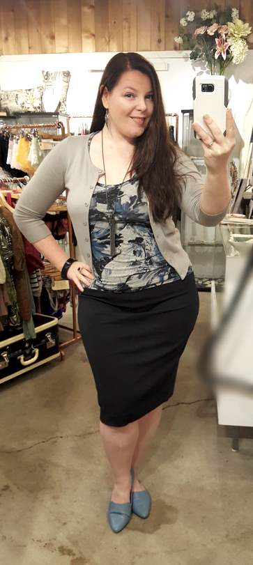 Paired with a navy pencil skirt and matching silver cotton cardigan for a professional look.
